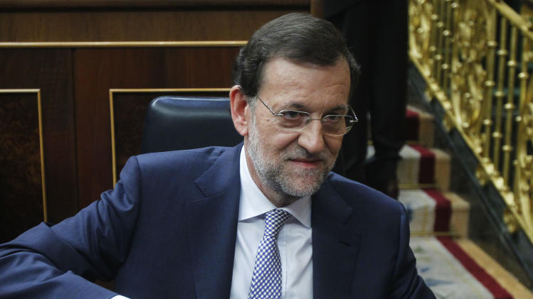 Spain's Prime Minister Mariano Rajoy prepares his papers during a control session at the Spanish Parliament, in Madrid, Spain, Wednesday, July 11, 2012. Spain has announced a euro 65 billion austerity package that includes tax hikes and spending cuts a day after winning approval from euro zone partners for a huge bailout of Spain's banks. (AP Photo/Andres Kudacki)