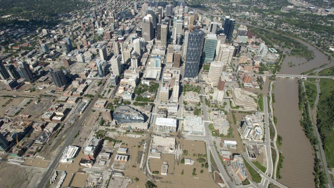 A flooded downtown Calgary, Alberta is seen from a aerial view of the city Saturday, June 22, 2013. The two rivers that converge on the western Canadian city of Calgary are receding Saturday after floods devastated much of southern Alberta province, causing at least three deaths and forcing thousands to evacuate. (AP Photo/The Canadian Press, Jonathan Hayward)