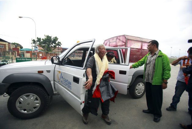 Japanese mountain climber Yuichiro Miura, 80, walks out from a vehicle upon his arrival at the airport after climbing Mount Everest, in Kathmandu