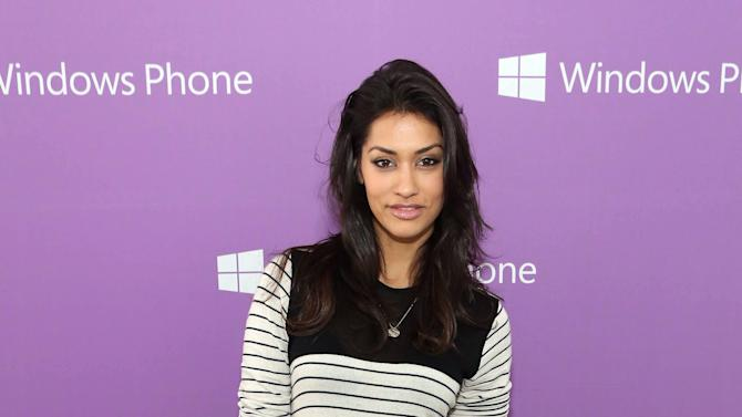 IMAGE DISTRIBUTED FOR MICROSOFT - Janina Gavankar is seen at The Microsoft Experience, on Thursday, Dec. 6, 2012 in Venice Beach, Calif. (Photo by Casey Rodgers/Invision for Microsoft/AP Images)