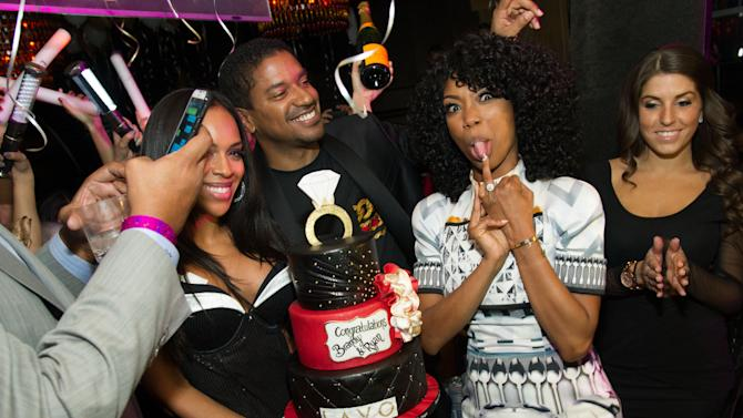 In this image released on Wednesday Jan. 2, 2013, R&B singer, Brandy and her fiance, Ryan Press, are seen on New Years Eve at Lavo Nightclub in Las Vegas. (Photo by Al Powers/Powers Imagery for TAO/Invision/AP)