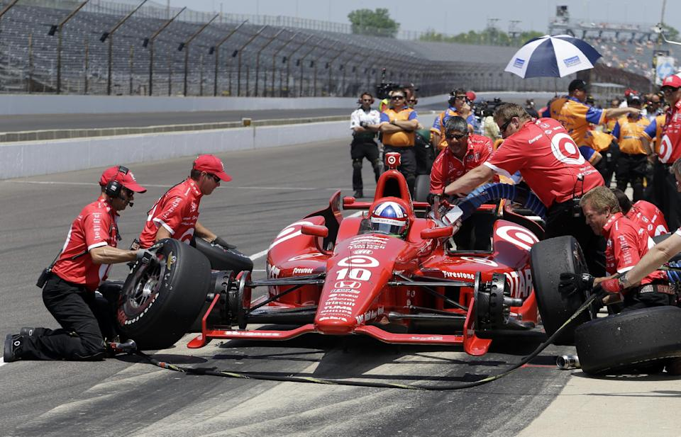 Dario Franchitti, of Scotland, practices a pit stop with his crew during practice on the first day of qualifications for the Indianapolis 500 auto race at the Indianapolis Motor Speedway in Indianapolis, Sunday, May 19, 2013. (AP Photo/Tom Strattman)