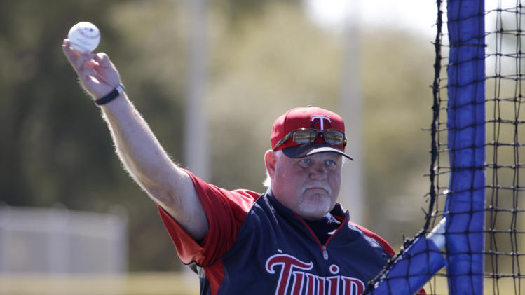 Minnesota Twins manager Ron Gardenhire throws batting practice to his traveling squad before a spring training baseball game against the Toronto Blue Jays in Dunedin, Fla., Saturday, March 8, 2014. (AP Photo/Kathy Willens)