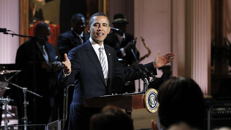 President Barack Obama welcomes guests during the White House Music