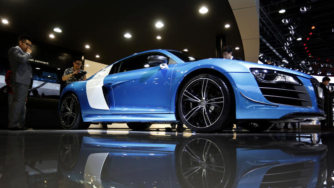 An Audi R8 China Edition sports car is displayed at the company's booth during the Guangzhou Auto Show in China's southern city of Guangzhou Thursday, Nov. 22, 2012. China's second largest auto show kicked off Thursday. (AP Photo/Vincent Yu)