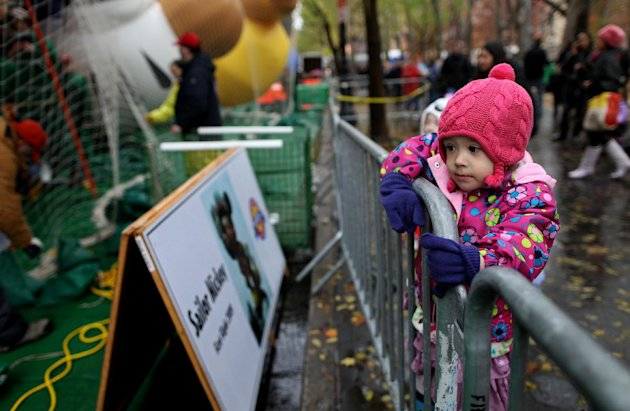 Madeline Adams, 3, of New York watches as participants in Macy&#39;s department store&#39;s 85th annual parade inflate giant helium balloons, Wednesday, Nov. 23, 2011 in preparation for Thursday&#39;s parade in New York. (AP Photo/Craig Ruttle)