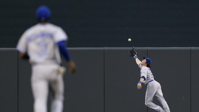 Toronto Blue Jays center fielder Colby Rasmus reaches for but can't catch a double by Baltimore Orioles' J.J. Hardy in the first inning of a baseball game in Baltimore, Friday, Aug. 24, 2012. (AP Photo/Patrick Semansky)