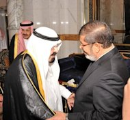 <p>A picture from the Egyptian Presidency shows Saudi King Abdullah (left) greeting Egyptian President Mohamed Morsi upon his arrival in Jeddah last week. Islamists scored a crushing victory in Egypt's three-stage parliamentary elections held from November last year, with the Muslim Brotherhood heading the lower house.</p>