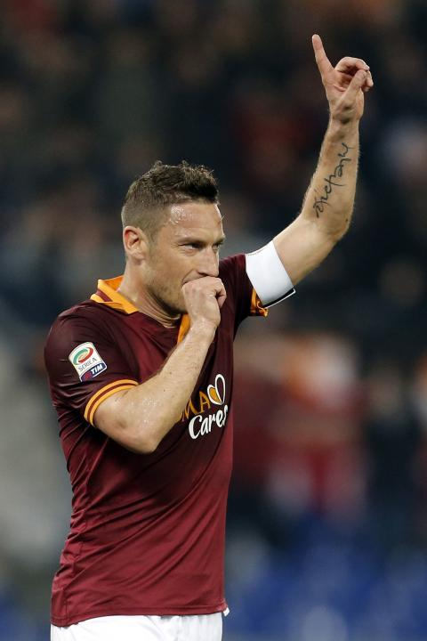AS Roma's Totti celebrates after scoring against Udinese during their Italian Serie A soccer match in Rome