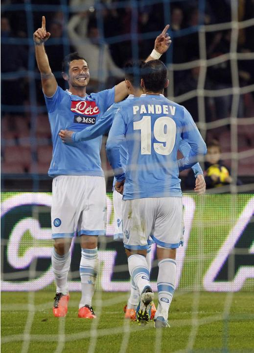 Napoli's Dzemaili celebrates with his team mates after scoring against Udinese during their Italian Serie A soccer match at San Paolo stadium in Naples
