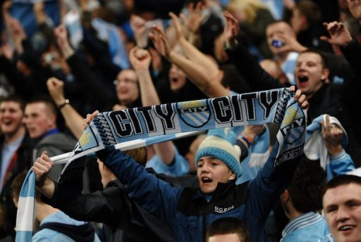Manchester City fans celebrate after a match