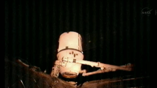 This image provided by NASA-TV shows the SpaceX Dragon commercial cargo craft after it was detached from the International Space Station at 4:10 a.m. EDT Tuesday March 26, 2013 by the International Space Station's Canadarm2 robotic arm. The two spacecraft were traveling over the western edge of California at the time. The Dragon is expected to splash down in the eastern Pacific ocean approximatel 246 miles off the coast of Baja Calif. later this morning. (AP Photo/NASA)