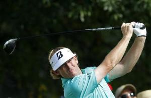 Snedeker of the U.S. reacts after finishing the first round of the BMW Championship golf tournament in Lake Forest