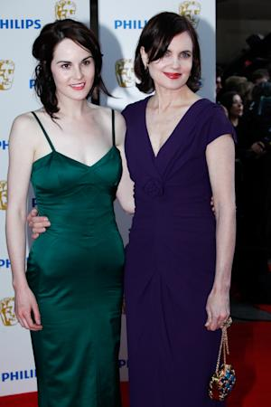"""FILE - In this May 22, 2011 file photo, actresses Michelle Dockery, left, and Elizabeth McGovern arrive at The British Academy Television Awards at The Grosvenor House Hotel, in London. Dockery and McGovern star in the Emmy nominated TV series """"Downton Abbey."""" (AP Photo/Paul Jeffers, file)"""