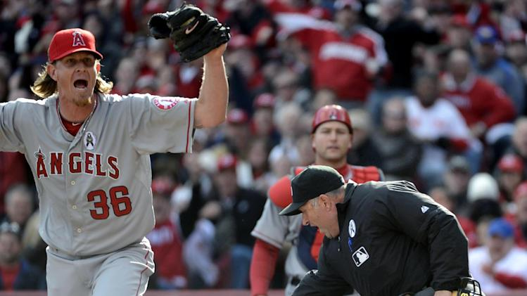 Los Angeles Angels starting pitcher Jered Weaver (36) reacts as home plate umpire Dale Scott signals Cincinnati Reds' Shin-Soo Choo was safe at home on a wild pitch in the third inning baseball game, Monday, April 1, 2013, in Cincinnati. (AP Photo/Michael Keating)