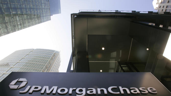 JPMorgan pays $100M, admits fault in London trades