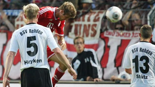 Thomas Mueller (C) scores 2-0 during the German Cup (DFB - Pokal) match against BSV Rehden (AFP)