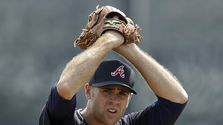 In this March 23, 2013, photo, Atlanta Braves pitcher Sean Gilmartin winds up during a spring training baseball game in Dunedin, Fla. The Braves acquired Ryan Doumit from the Minnesota Twins on Wednesday, Dec. 18, 2013, for Gilmartin