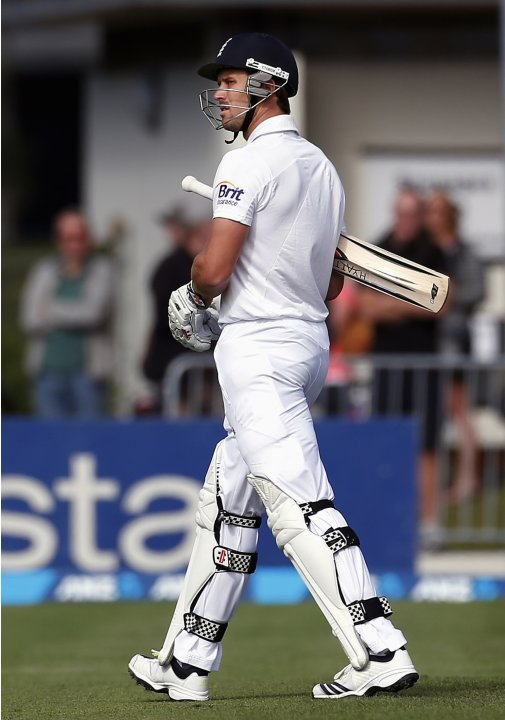 England's Compton walks off the ground after being dismissed for 117 runs during the fifth day of the first test against New Zealand at the University Oval in Dunedin