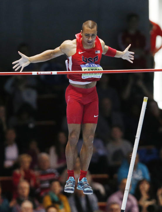 United States' Ashton Eaton clears the bar in the pole-vault of the heptathlon during the Athletics World Indoor Championships in Sopot, Poland, Saturday, March 8, 2014