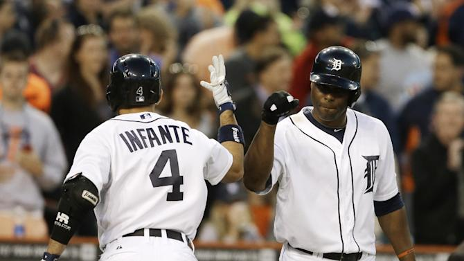 Detroit Tigers' Omar Infante (4) is greeted at the dugout by Torii Hunter after his solo home run during the fifth inning of a baseball game against the Tampa Bay Rays in Detroit, Tuesday, June 4, 2013. (AP Photo/Carlos Osorio)
