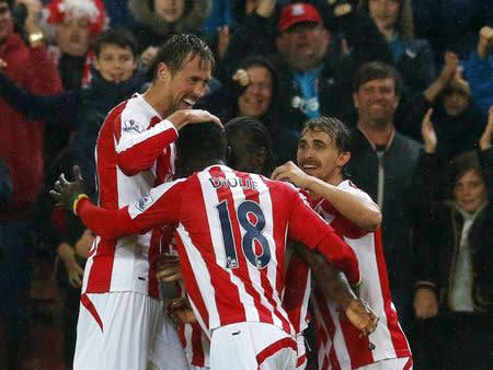 Stoke City's Crouch celebrates with team mates after scoring a goal during their English Premier League soccer match against Newcastle United at the Britannia stadium in Stoke on Trent