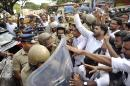 Police stop students who were protesting following the rape and murder of a law student in Kochi, Kerala state, India, Tuesday, May 3, 2016. Police detained three men for questioning Tuesday in the rape and murder of a law student whose body was found mutilated in southern India, officials said.The case has drawn comparisons to the deadly 2012 gang rape of a woman on a New Delhi bus that sparked widespread outrage and nationwide protests demanding an end to the widespread sexual assault and abuse of women across India.(Press Trust of India via AP) INDIA OUT, MANDATORY CREDIT, NO ARCHIVE