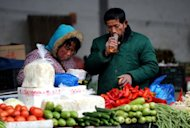 &lt;p&gt;Vendors wait for customers at a vegetable market in Hefei, east China&#39;s Anhui province, last month. China&#39;s inflation rate edged up in March from the previous month, according to official data, as bad weather pushed up food prices and authorities raised the price of fuel.&lt;/p&gt;