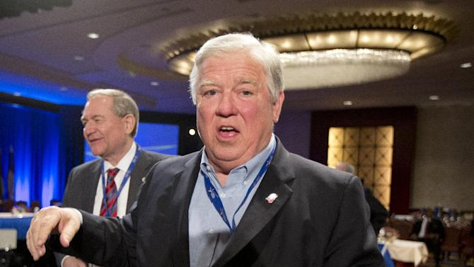 "Former Mississippi Gov. Haley Barbour leaves a Health and Homeland Security Committee meeting titled ""Protecting Our Nation: States and Cybersecurity"" during the National Governors Association 2013 Winter Meeting in Washington on Saturday, Feb. 23, 2013. Former Virginia Gov. Jim Gilmore is at left. (AP Photo/Manuel Balce Ceneta)"