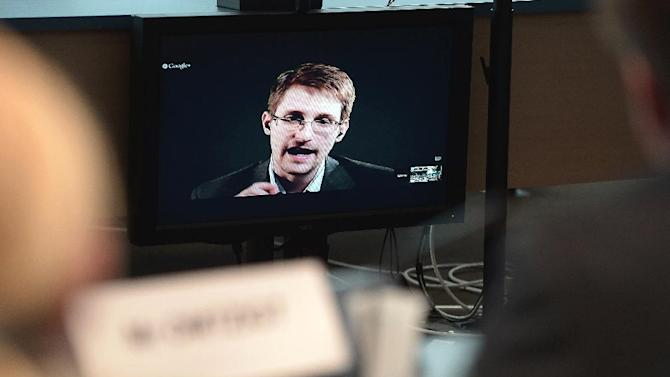 Ex-US National Security Agency (NSA) contractor Edward Snowden speaks to European officials in Strasbourg, via video conference, on June 24, 2014