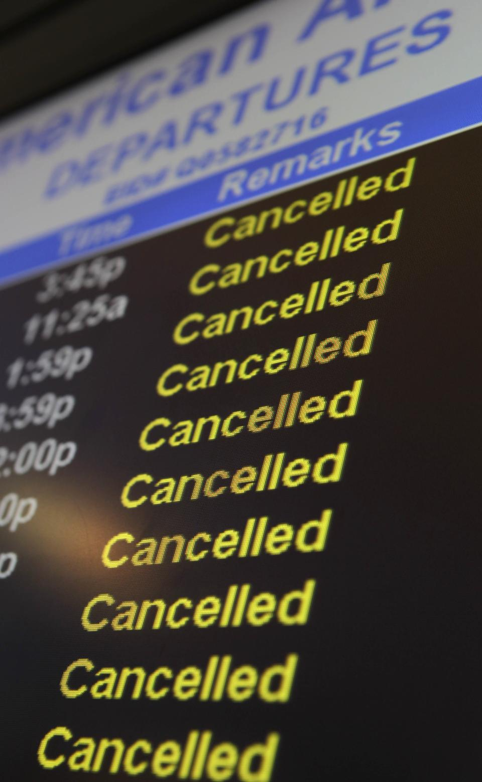 A list of canceled flights is displayed at John F. Kennedy International Airport in New York, Monday, Dec. 27, 2010.  (AP Photo/Seth Wenig)