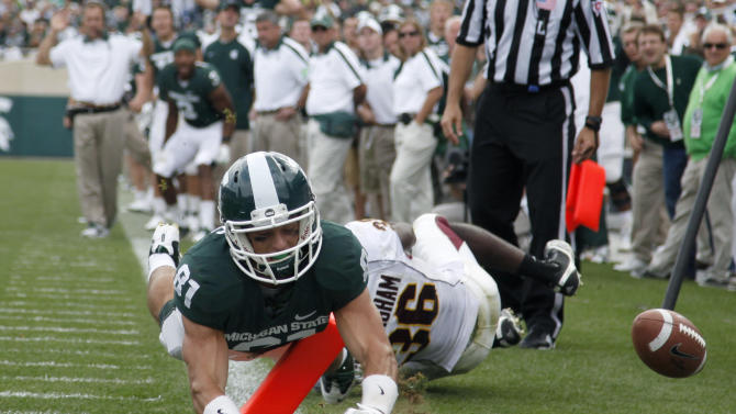 Michigan State's Brad Sonntag (81) fumbles the ball out-of-bound short of the goal line in front of Central Michigan's Avery Cunningham, rear, during the fourth quarter of an NCAA college football game, Saturday, Sept. 24, 2011, in East Lansing, Mich. Michigan State won 45-7. (AP Photo/Al Goldis)