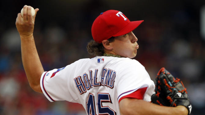 Texas Rangers starting pitcher Derek Holland  throws a pitch during the first inning of a baseball game against the Detroit Tigers Sunday, May 19, 2013, in Arlington.  (AP Photo/John F. Rhodes)