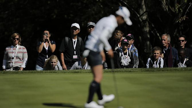 Supporters look at Ai Miyazato, of Japan, who plays on the 1st hole during the first round of the Evian Championship women's golf tournament in Evian, eastern France, Friday, Sept. 13, 2013. (AP Photo/Laurent Cipriani)
