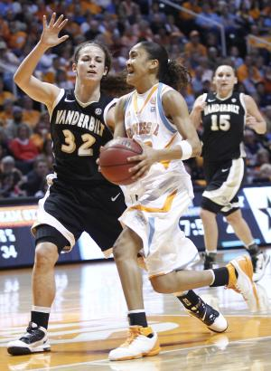 Tennessee's Meighan Simmons, front right, drives against Vanderbilt's Gabby Smith (32) during the second half of an NCAA college basketball game Saturday, Jan. 15, 2011, in Knoxville, Tenn. Tennessee won 68-56. (AP Photo/Wade Payne)