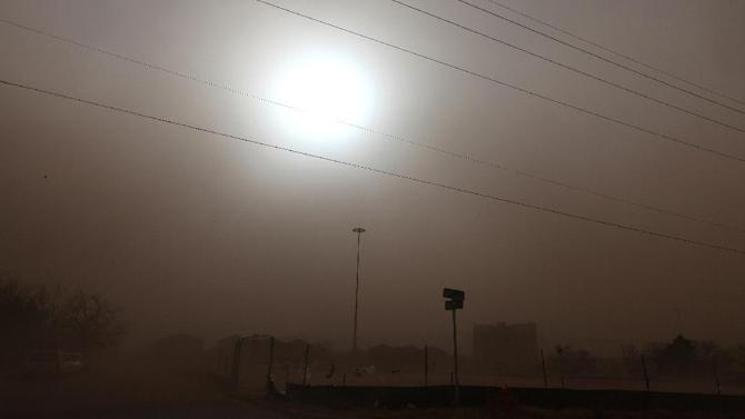 Dust covers a residential area during a dust storm in Lubbock, Texas, Wednesday, Dec. 19, 2012.(AP Photo/Lubbock Avalanche-Journal, Zach Long) ALL LOCAL TV OUT