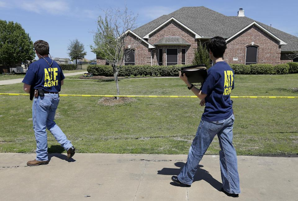 ATF agents walk into the home of Kaufman District Attorney Mike McLelland Monday, April 1, 2013, near Forney, Texas. McLelland and his wife were murdered on Saturday at their home. (AP Photo/Tony Gutierrez)