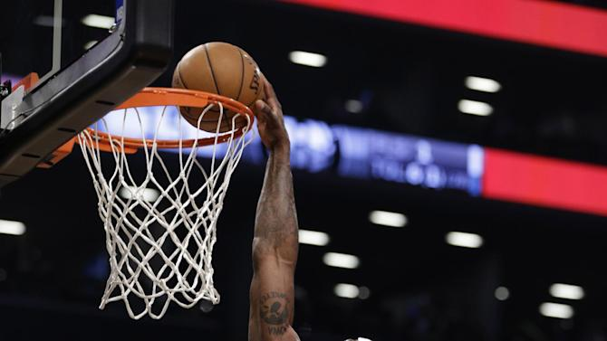 Brooklyn Nets forward Reggie Evans (30) dunks in the first half of Game 5 of their first-round NBA basketball playoff series against the Chicago Bulls, Monday, April 29, 2013, in New York. (AP Photo/Kathy Willens)