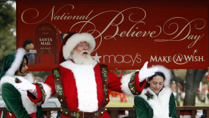 "Macy's Santa, with the help of his elves Sparkle and Jingle Belle, reads "" 'Twas the Night Before Christmas"" during a visit to the Fort Worth Stockyards Friday, December 14, 2012. Macy's grants ""Wishes Across America"" on National Believe Day and brings Santa to Dallas and Fort Worth for Macy's National Santa Tour. (Richard W. Rodriguez /AP Images for Macy's)"