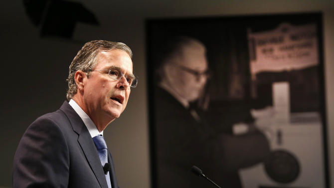 Republican presidential candidate, former Florida Gov. Jeb Bush announces his plan to end President Obama's health care law, Tuesday, Oct. 13, 2015, at the New Hampshire Institute of Politics at Saint Anselm College in Manchester, N.H. (AP Photo/Jim Cole)