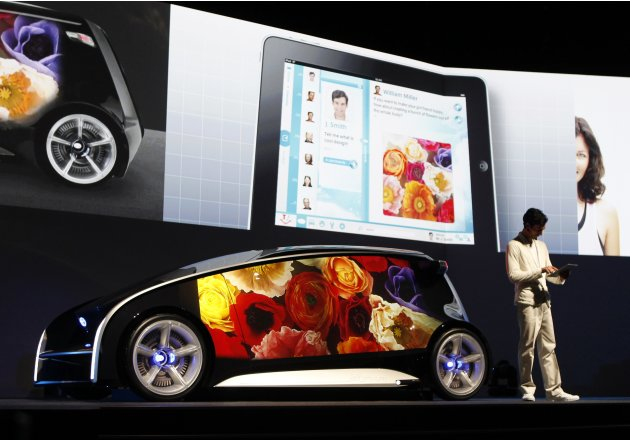 A model presents Toyota's concept vehicle Fun-Vii at a pre-Tokyo Motor show reception in a showroom in Tokyo