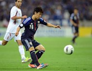 Japan's Shinji Kagawa (C) during the World Cup qualifying match against Jordan on June 8. Kagawa said Wednesday life at Manchester United was a daunting prospect, in his first public comments after his transfer was confirmed earlier this month