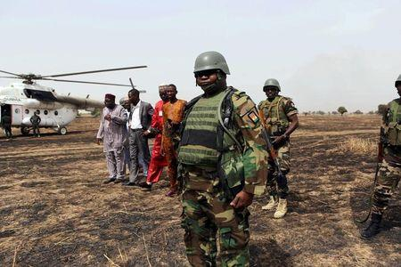 Colonel Barmou Salaou, commander of Niger's armed forces in the Diffa region, looks on after landing in Damasak