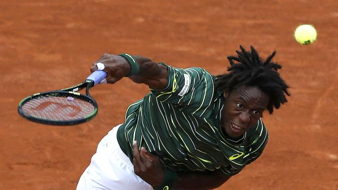 Gael Monfils of France plays a shot to compatriot Edouard-Roger Vasselin during their men's singles match at the French Open tennis tournament at the Roland Garros stadium in Paris