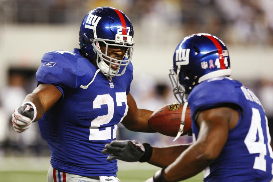 New York Giants running back Brandon Jacobs celebrates his touchdown with teammate Ahmad Bradshaw during the second half an NFL football game Monday, Oct. 25, 2010, in Arlington, Texas. The Giants won 41-35. (AP Photo/Mike Fuentes)