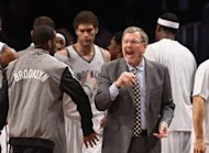 Interim coach P.J. Carlesimo of the Brooklyn Nets argues with a ref in the game against the Charlotte Bobcats at the Barclays Center on December 28, 2012 in the Brooklyn borough of New York City. The Nets won 97-81