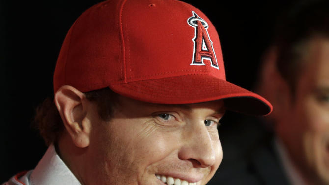 Free-agent outfielder Josh Hamilton talks to the media during a news conference in Anaheim, Calif., Saturday, Dec. 15, 2012. Hamilton, formerly of the Texas Rangers, joins the Los Angeles Angels MLB baseball team after signing a $125 million, five-year contract. (AP Photo/Chris Carlson)