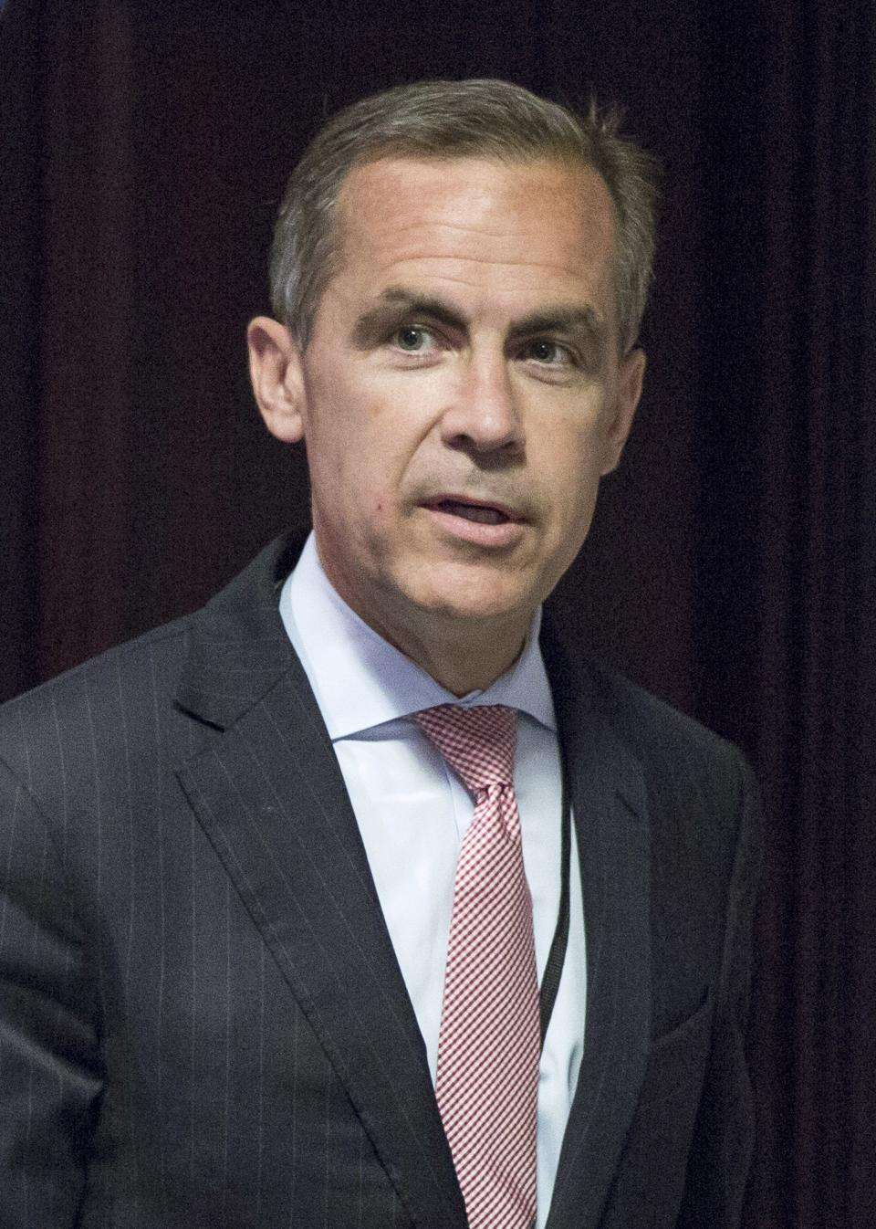 Mark Carney, the new Governor of the Bank of England, arrives to attend a monetary policy committee (MPC) briefing on his first day on the job inside the central bank's headquarters in London Monday July 1, 2013. (AP Photo/Jason Alden/Pool)