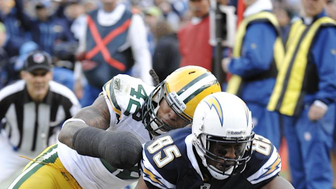 San Diego Chargers tight end Antonio Gates, right, scores a touchdown as Green Bay Packers free safety Morgan Burnett defends in the third quarter of an NFL football game, Sunday, Nov. 6, 2011, in San Diego. (AP Photo/Denis Poroy)