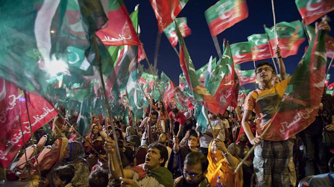 Supporters of Pakistan Tehreek-e-Insaf or Moment for Justice party attend an election campaign rally in Islamabad, Pakistan, Thursday, May 9, 2013. Pakistan is scheduled to hold parliamentary elections on May 11, the first transition between democratically elected governments in a country that has experienced three military coups and constant political instability since its creation in 1947. The parliament's ability to complete its five-year term has been hailed as a significant achievement. (AP Photo/Anjum Naveed)